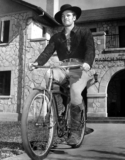 Charlton Heston on a Bike
