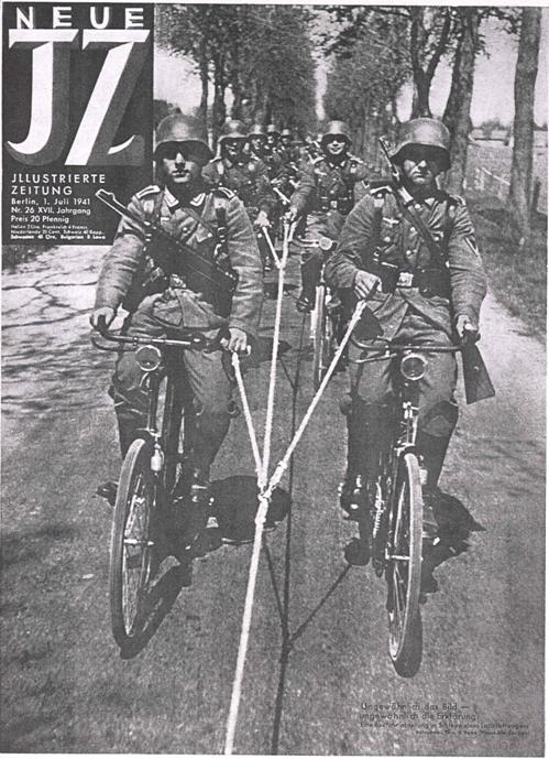A German bicycle infantry troop gets a motorized assist in a training exercise.